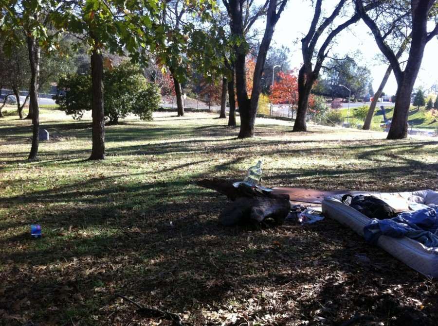 Homeless bed and grave in 'park' in Auburn, CA